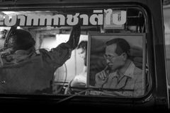 King of Thailand (King Bhumibol Adulyadej) inside car. As beloved of us all. Royalty Free Stock Photography