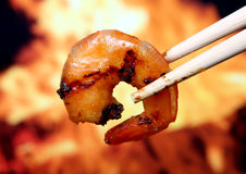King tiger prawn shrimp food by fire and flame royalty free stock images