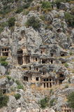 King tombs carved into rocks in myra antalya Stock Photo