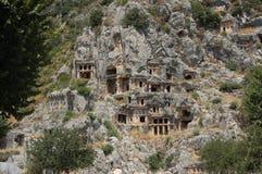 King tombs carved into rocks in myra antalya Stock Image