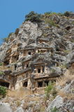 King tombs carved into rocks in myra antalya Royalty Free Stock Image