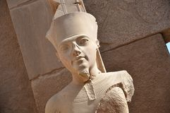 King Tut as the Great God Amun at Karnak Temple. Aswan, Egypt. King Tut, known as the Great God Amun in the Temple of Karnak in Luxor. Aswan, Egypt Stock Photography
