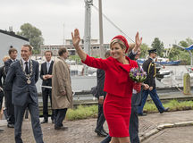King Willem Alexander and Queen maxima waving to the people in H Royalty Free Stock Photos