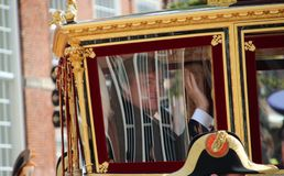 King Willem Alexander in Royal coach driving on Lange Voorhout on the Prince day Parade in The Hague. The Netherlands Royalty Free Stock Photography