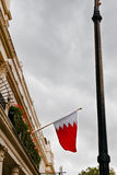 The Kingdom of Bahrain flag waving from the embassy balcony in London exterior view Stock Image