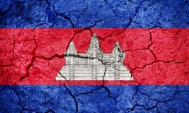 Kingdom of Cambodia flag. On dry earth ground texture background Royalty Free Stock Images