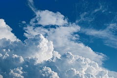 Kingdom of Heaven (cumulonimbus). Big gorgeous white clouds on blue saturated sky Royalty Free Stock Photography