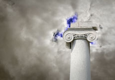 Kingdom of the heavens. Concept photo of architectural column reaching into the top of the clouds supporting kingdom of the heavens royalty free stock photos
