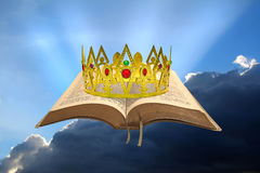 Kingdom of the heavens. Concept photo of kingdom of the heavens with golden crown on open bible representing peaceful reign of jesus christ as king Stock Photo