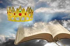 Kingdom of the heavens. Concept photo of kingdom of the heavens with golden crown and open bible representing peaceful reign of jesus christ as king Stock Photo