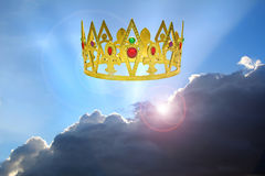 Kingdom of the heavens. Concept photo of kingdom of the heavens with golden crown and sun rays representing peaceful reign of jesus christ as king stock photography