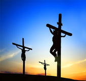 Kingdom of the heavens. Jesus Christ with others on the cross is dying Stock Photos
