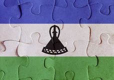 Kingdom of Lesotho flag puzzle Stock Photo