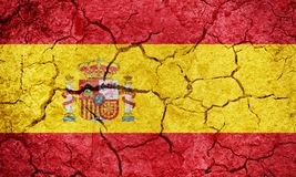 Kingdom of Spain flag. On dry earth ground texture background stock illustration