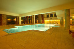 Kingdom swimming pools. Beautiful resort spa pools highlighted very nice interior arrangemen Stock Images