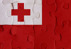Kingdom of Tonga flag puzzle. Illustration of a flag of Kingdom of Tonga over some puzzle pieces. Its a JPG image Royalty Free Stock Photography