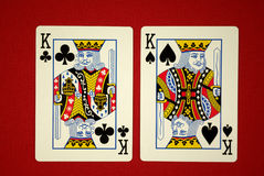 Kings. Poker hand, pocket kings close up on red felt Stock Photos