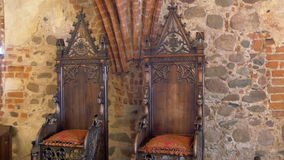 The kings chair displayed inside the old castle in Trakai GH4 4K UHD. The kings chair displayed inside the old castle in Trakai Lithuania very pretty and antique stock footage