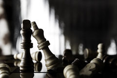 Kings Chess pieces standing on a chessboard Stock Images