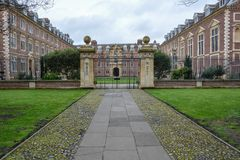 Kings College building in Cambridge with a gate and cloudy sky stock image