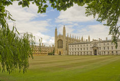 Kings College, Cambridge. View of Kings College, Cambridge in the summer, framed through the trees close to the river Cam Stock Photos