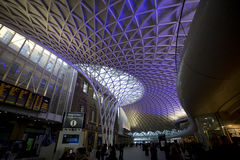 Kings Cross Station. London, United Kingdom - December 2, 2012: The purple illuminated ceiling of King's Cross Railway station, passengers visible Stock Photography