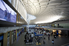Kings Cross Station. London, United Kingdom - December 2, 2012: View of inside of the Kings Cross Station on a busy day, showing passengers and commuters waiting Royalty Free Stock Images