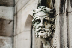 Kings face adorns a doorway. A kings face carved from stone decorating a doorway. Otherwise known as a mascaron. 27 Oct 2016 Royalty Free Stock Photos