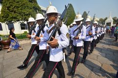 Kings Guards are marching in Grand Royal Palace in Bangkok Stock Image