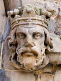 Kings head. Caved head on ancient church in Birmingham, England Stock Image
