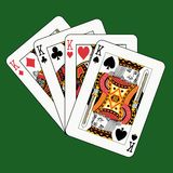 Kings poker on green. Playing cards on green background Stock Photography