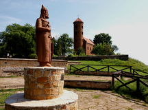 Kings and the temple. Monument to the Polish King Wladyslaw Herman and his son Boleslaw Boleslaw on a hill in Inowłodz. In the background the historic Royalty Free Stock Photo