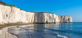 Kingsgate Bay, Margate, East Kent, UK. Panoramic view of white chalk cliffs and beach in Kingsgate Bay, Margate, East Kent, UK royalty free stock photos