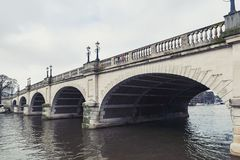 Kingston Bridge carrying the A308 Horse Fair Road across the River Thames in Kingston, England. Kingston upon Thames, United Kingdom - April 2018: Kingston Stock Photo