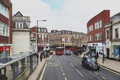 Business and shopping area on Eden Street, Kingston upon Thames in Greater London, England. Kingston upon Thames, United Kingdom - April 2018: Business and Royalty Free Stock Image