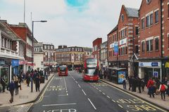 Business and shopping area on Eden Street, Kingston upon Thames in Greater London, England. Kingston upon Thames, United Kingdom - April 2018: Business and Royalty Free Stock Photography