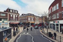 Business and shopping area on Eden Street, Kingston upon Thames in Greater London, England. Kingston upon Thames, United Kingdom - April 2018: Business and Royalty Free Stock Images