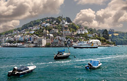 Kingswear in Devon. Kingswear is a village in Devon with many properties on the hillside in enviable locations with beautiful views of the river Dart estuary and Royalty Free Stock Photos