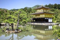 Kinkaku-ji, Golden Pavillion temple, Kyoto, Japan. Japanesse garden with pond, small island with pines, and buddhist temple Kinkaku-ji - Golden Pavillion - in Stock Image
