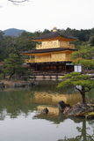Kinkaku-ji. Officially named Rokuon-ji, is a Zen Buddhist temple in Kyoto, Japan. The garden complex is an excellent example of Muromachi period garden design Stock Photos