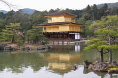Kinkaku-ji. Officially named Rokuon-ji, is a Zen Buddhist temple in Kyoto, Japan. The garden complex is an excellent example of Muromachi period garden design Royalty Free Stock Photo