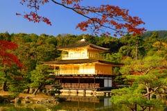 Kinkaku-ji Temple. Fall foliage at Kinkaku-ji temple in Kyoto, Japan. Kinkaku-ji literally means Temple of the Golden Pavilion. This temple is a Zen temple in stock photography