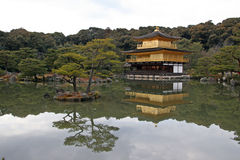 Kinkaku-ji Temple (Golden Pavilion). It is perhaps the most widely-recognized image of Kyoto: the small, graceful temple whose upper tiers, balconies and eaves Stock Images