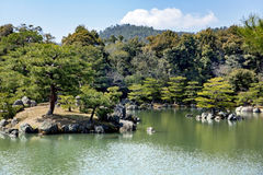 Kinkaku-ji Temple or Golden Pavilion. Officially named Rokuon-ji is set in a magnificent Japanese strolling garden. The pond contains 10 smaller islands where Royalty Free Stock Images