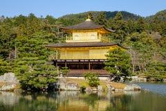 Kinkaku-ji Temple in Kyoto Japan. Kinkaku-ji Temple with pine tree garden in Kyoto Japan. The Golden Pavilion Kinkaku is a three-story building on the grounds of Royalty Free Stock Photography