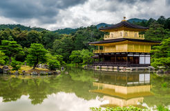 Kinkaku-Ji temple in Kyoto. The Kinkau-Ji Golden pavilion in Kyoto Japan on an overcast day Royalty Free Stock Photo