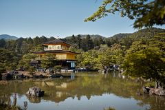 Kinkaku-Ji temple surrounded by forest royalty free stock photography