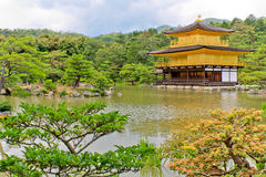 Kinkakuji Golden Pavilion. Located in  northern Kyoto, Kinakuji is a zen temple famously known for having its top two floors covered in gold leaf. Also known as Royalty Free Stock Photo