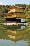 Kinkakuji Temple. Front view of the golden temple or Kinkakuji in Kyoto, Japan with the reflection in the water Royalty Free Stock Image