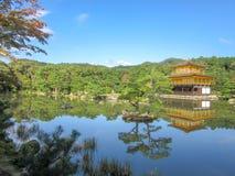 Kinkakuji temple near lake stock photography